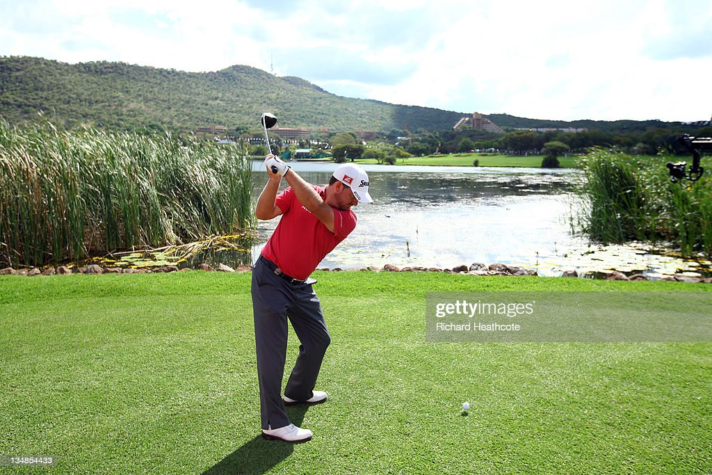 <a gi-track='captionPersonalityLinkClicked' href=/galleries/search?phrase=Graeme+McDowell&family=editorial&specificpeople=196520 ng-click='$event.stopPropagation()'>Graeme McDowell</a> of Northern Ireland in action during the final round of the Nedbank Golf Challenge at the Gary Player Country Club on December 4, 2011 in Sun City, South Africa.