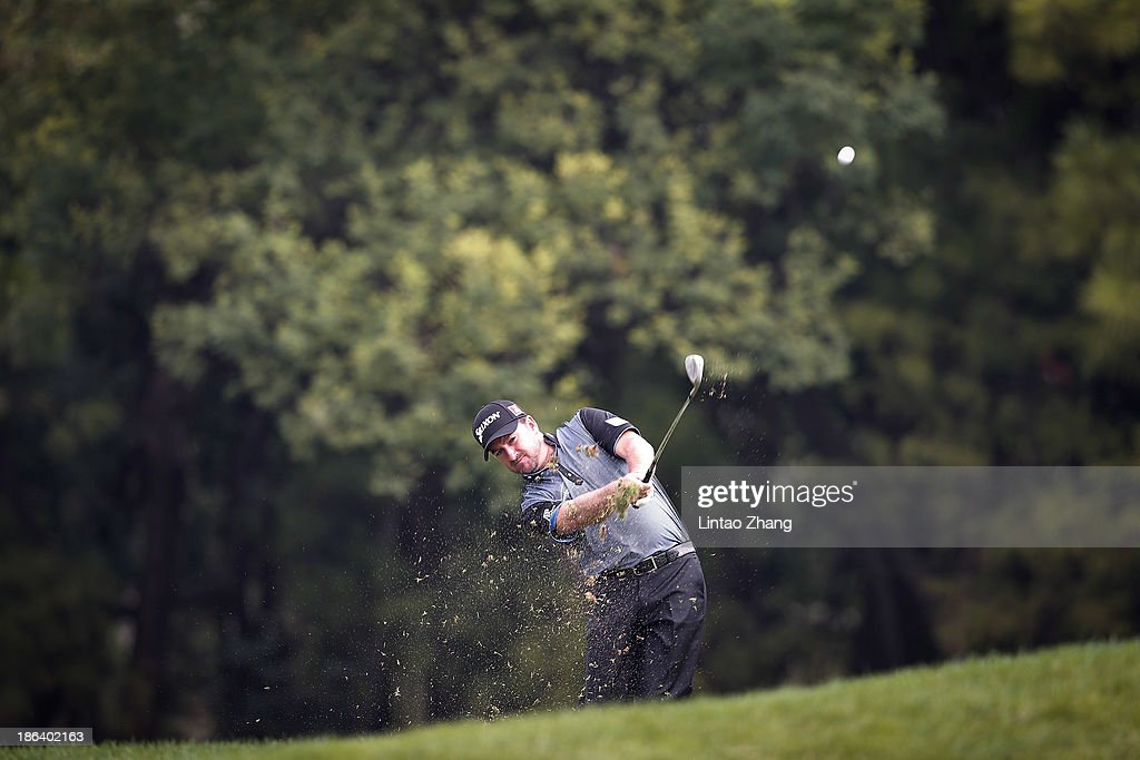 <a gi-track='captionPersonalityLinkClicked' href=/galleries/search?phrase=Graeme+McDowell&family=editorial&specificpeople=196520 ng-click='$event.stopPropagation()'>Graeme McDowell</a> of Northern Ireland in action during the first round of the WGC-HSBC Champions at the Sheshan International Golf Club on October 31, 2013 in Shanghai, China.