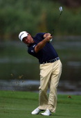 Graeme McDowell of Northern Ireland in action during the second round of the Nedbank Golf Challenge at the Gary Player Country Club on December 2...