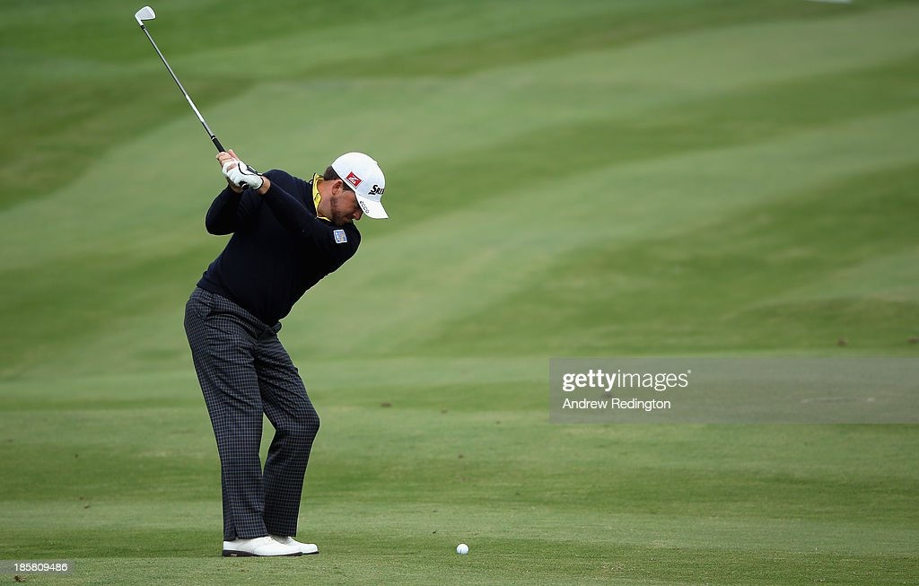 <a gi-track='captionPersonalityLinkClicked' href=/galleries/search?phrase=Graeme+McDowell&family=editorial&specificpeople=196520 ng-click='$event.stopPropagation()'>Graeme McDowell</a> of Northern Ireland in action during the second round of the BMW Masters at Lake Malaren Golf Club on October 25, 2013 in Shanghai, China.