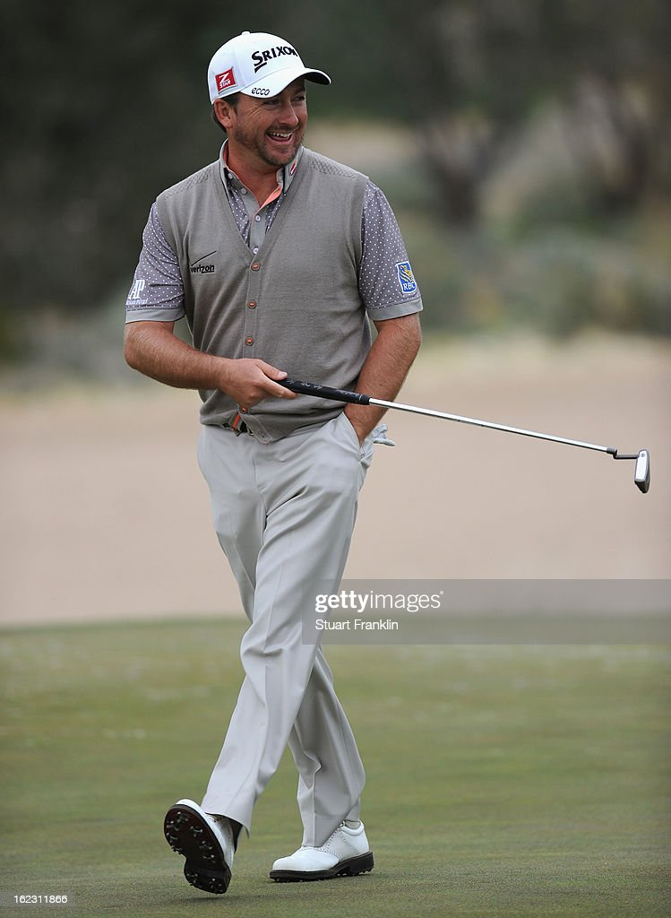 Graeme McDowell of Northern Ireland looks happy during the first round of the World Golf Championships - Accenture Match Play at the Golf Club at Dove Mountain on February 21, 2013 in Marana, Arizona. Round one play was suspended on February 20 due to inclimate weather and is scheduled to be continued today.