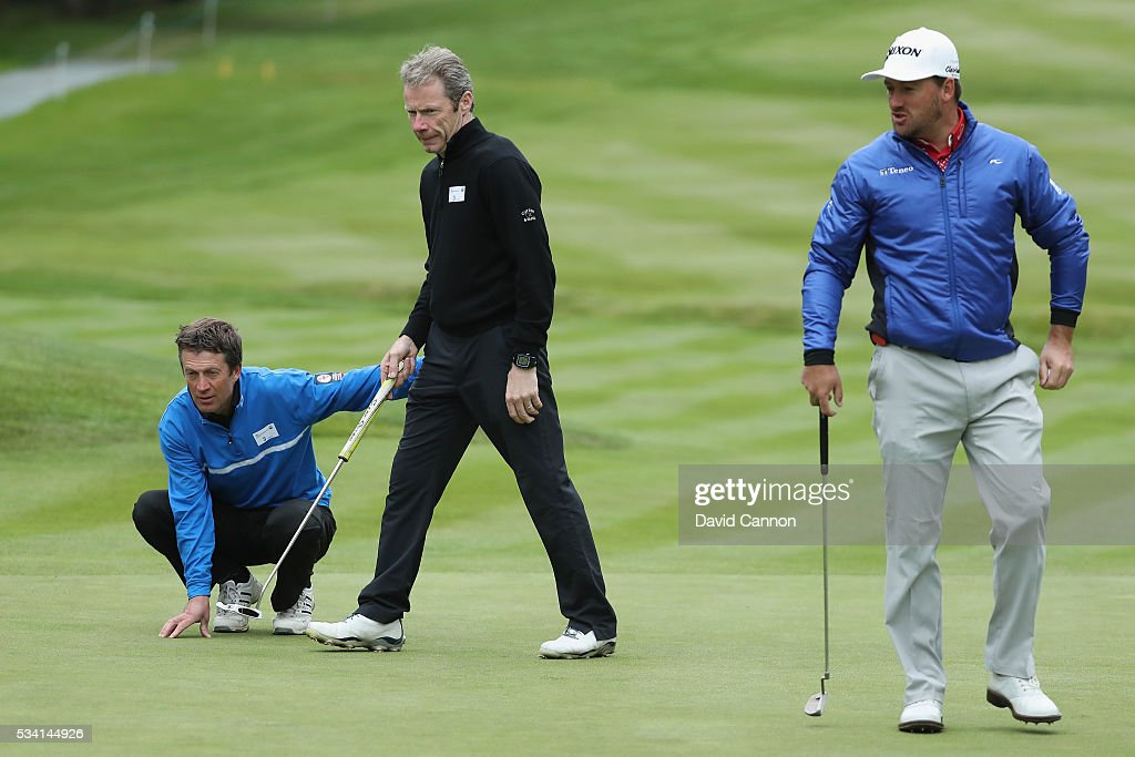 Graeme McDowell of Northern Ireland looks on with Jockeys <a gi-track='captionPersonalityLinkClicked' href=/galleries/search?phrase=Carl+Llewellyn&family=editorial&specificpeople=220479 ng-click='$event.stopPropagation()'>Carl Llewellyn</a> and Mick Fiztgerald during the Pro-Am prior to the BMW PGA Championship at Wentworth on May 25, 2016 in Virginia Water, England.