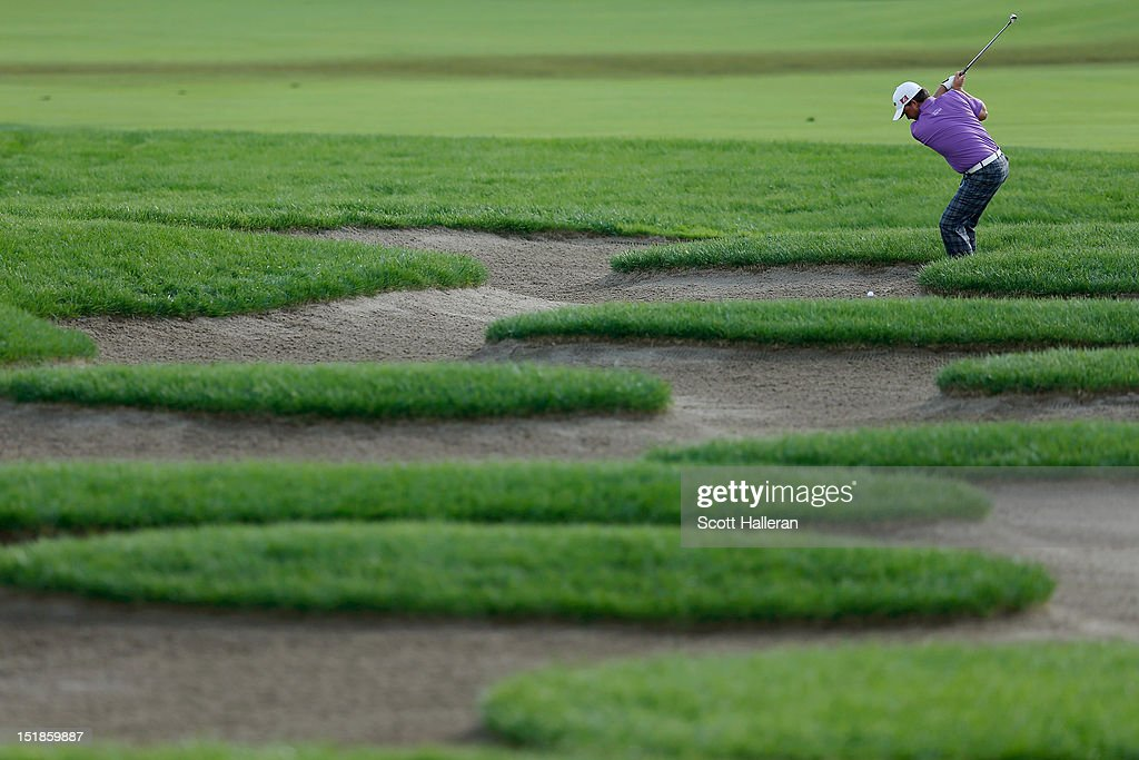 <a gi-track='captionPersonalityLinkClicked' href=/galleries/search?phrase=Graeme+McDowell+-+Golfer&family=editorial&specificpeople=196520 ng-click='$event.stopPropagation()'>Graeme McDowell</a> of Northern Ireland plays a bunker shot on the 11th hole during the third round of the BMW Championship at Crooked Stick Golf Club on September 8, 2012 in Carmel, Indiana.