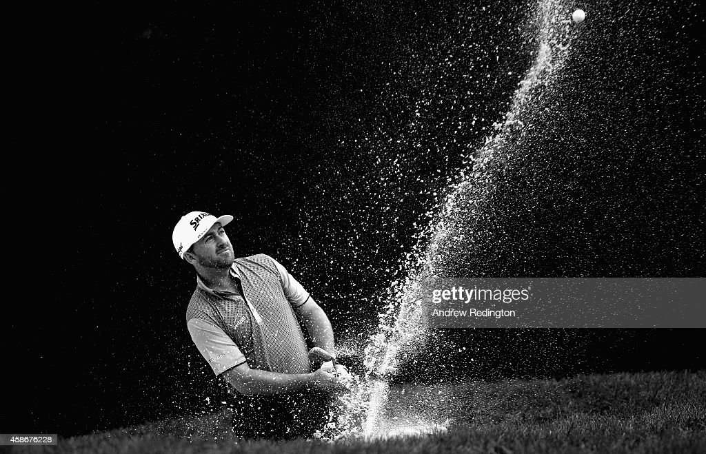 Graeme McDowell of Northern Ireland plays a bunker shot on the 15th hole during the final round of the WGC - HSBC Champions at the Sheshan International Golf Club on November 9, 2014 in Shanghai, China.