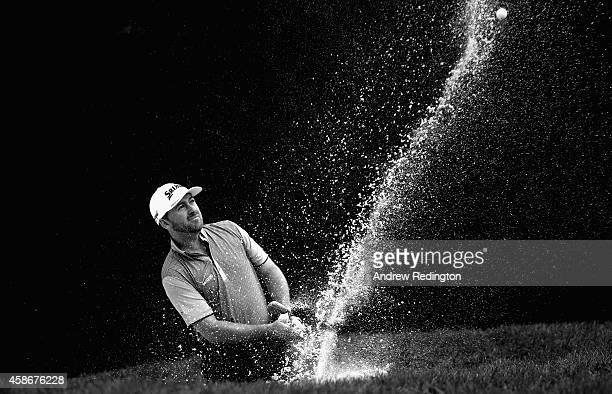 Graeme McDowell of Northern Ireland plays a bunker shot on the 15th hole during the final round of the WGC HSBC Champions at the Sheshan...