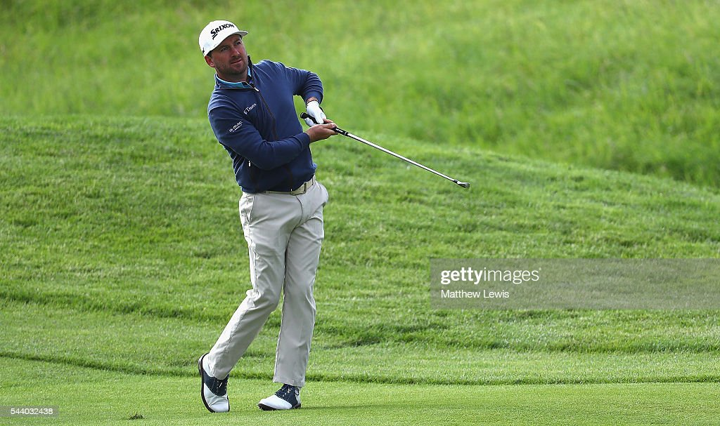 <a gi-track='captionPersonalityLinkClicked' href=/galleries/search?phrase=Graeme+McDowell+-+Golfer&family=editorial&specificpeople=196520 ng-click='$event.stopPropagation()'>Graeme McDowell</a> of Northern Ireland plays a shot from the fairway during day two of the 100th Open de France at Le Golf National on July 1, 2016 in Paris, France.