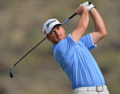 Graeme McDowell of Northern Ireland plays a shot on the 16th hole during the quarterfinal round of the World Golf Championships Accenture Match Play...