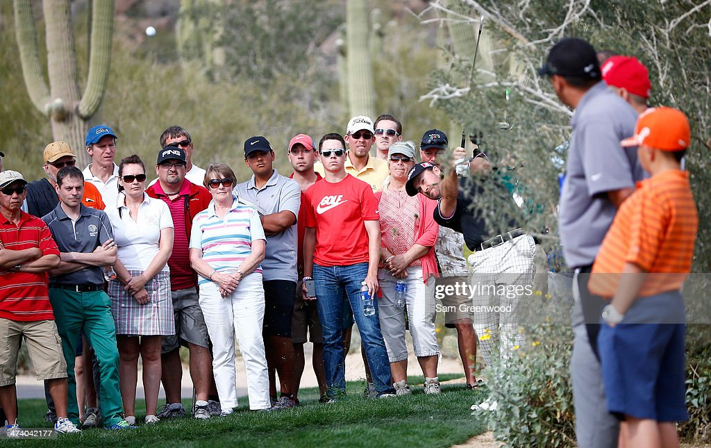 Graeme McDowell of Northern Ireland plays a shot on the 17th hole during the third round of the World Golf Championships - Accenture Match Play Championship at The Golf Club at Dove Mountain on February 21, 2014 in Marana, Arizona.
