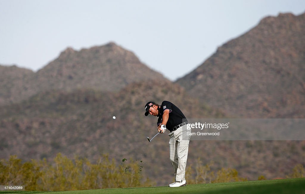 Graeme McDowell of Northern Ireland plays a shot on the 19th hole during the third round of the World Golf Championships - Accenture Match Play Championship at The Golf Club at Dove Mountain on February 21, 2014 in Marana, Arizona.