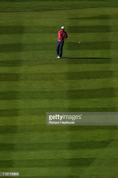 Graeme McDowell of Northern Ireland plays his approach to the 18th green during the second round of the Saab Wales Open on the Twenty Ten course at...