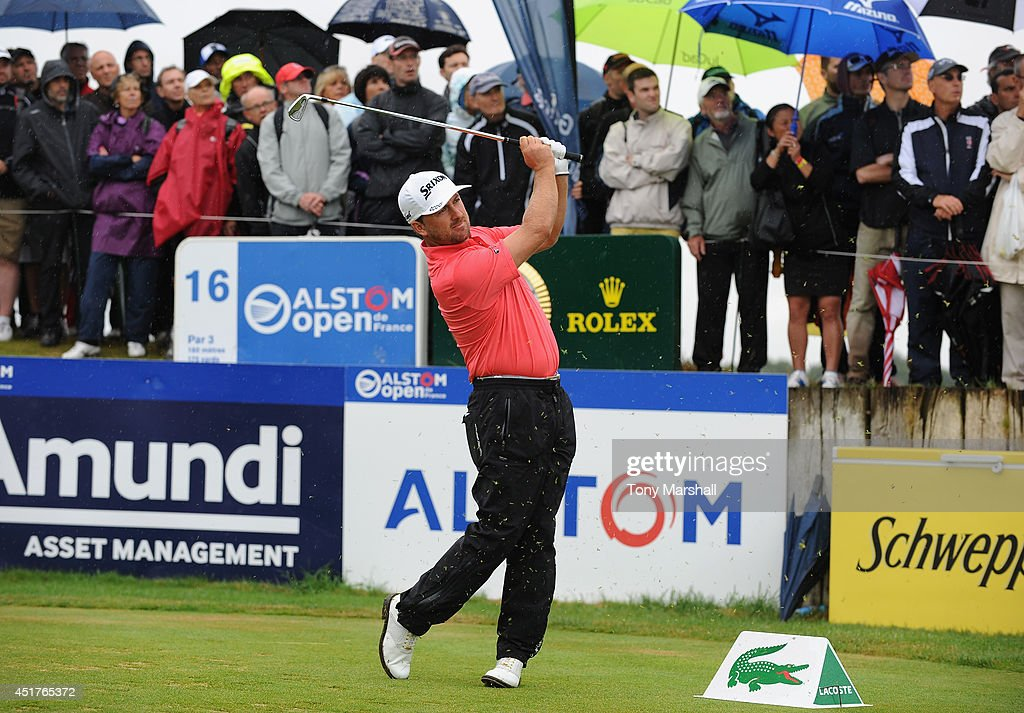 <a gi-track='captionPersonalityLinkClicked' href=/galleries/search?phrase=Graeme+McDowell+-+Golfer&family=editorial&specificpeople=196520 ng-click='$event.stopPropagation()'>Graeme McDowell</a> of Northern Ireland plays his first shot on the 16th tee during the Alstom Open de France - Day Four at Le Golf National on July 6, 2014 in Paris, France.