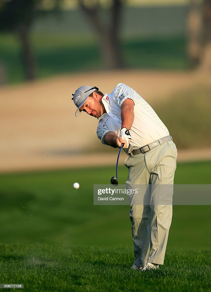 Graeme McDowell of Northern Ireland plays his second shot on the par 5 10th hole during the first round of the 2016 Omega Dubai Desert Classic on the...