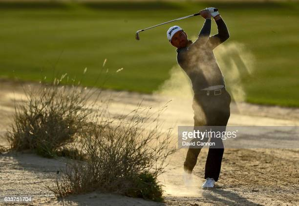Graeme McDowell of Northern Ireland plays his second shot on the par 4 eighth hole during the completion of the weather delayed second round of the...