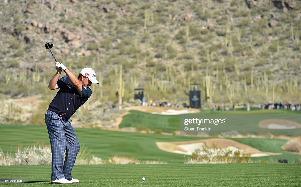 Graeme McDowell of Northern Ireland plays his tee shot on the 15th hole during the second round of the World Golf Championships - Accenture Match Play at the Golf Club at Dove Mountain on February 22, 2013 in Marana, Arizona.