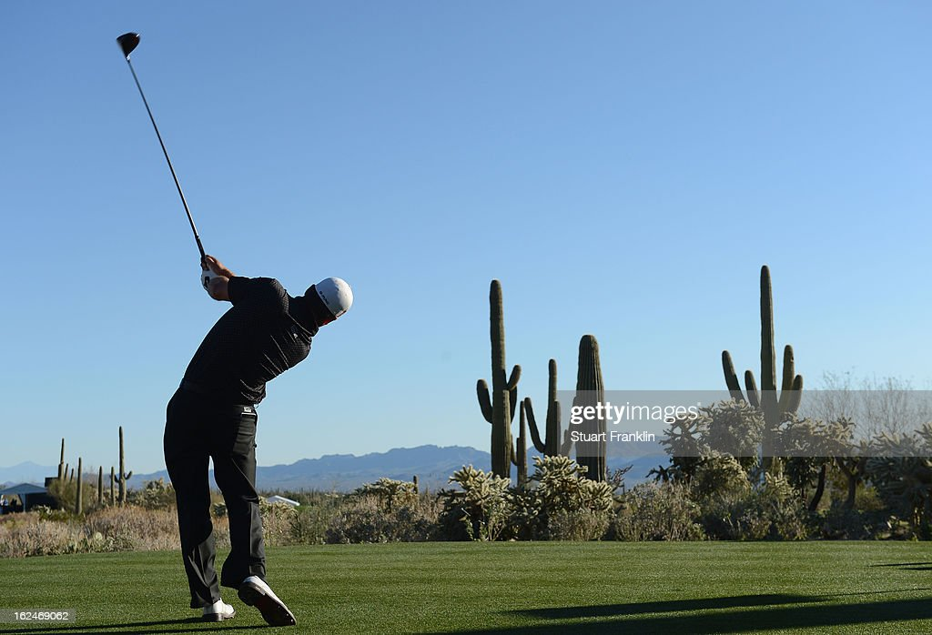 Graeme McDowell of Northern Ireland plays his tee shot on the 17th hole during the quarterfinal round of the World Golf Championships - Accenture Match Play at the Golf Club at Dove Mountain on February 23, 2013 in Marana, Arizona.