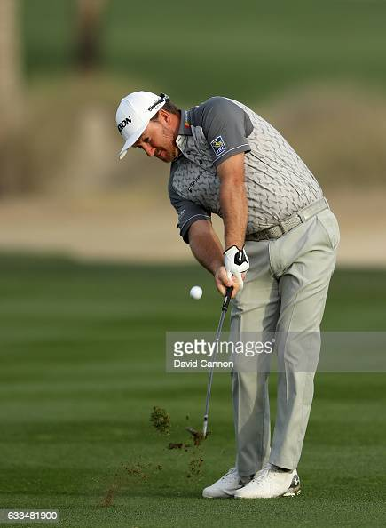 Graeme McDowell of Northern Ireland plays his third shot to the par 5 10th hole during the first round of the 2017 Omega Dubai Desert Classic on the...