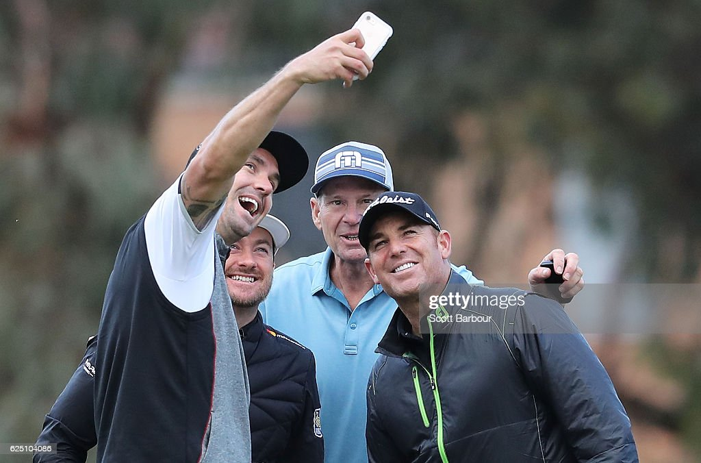 Graeme McDowell (2nd L) of Northern Ireland poses for a selfie photo with former cricketers Kevin Pietersen (L) and Shane Warne (R) and former AFL player Sam Newman on Pro-Am Day ahead of the World Cup of Golf at Kingston Heath Golf Club on November 23, 2016 in Melbourne, Australia.
