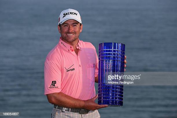 Graeme McDowell of Northern Ireland poses with the trophy after winning the Volvo World Match Play Championship at Thracian Cliffs Golf Beach Resort...