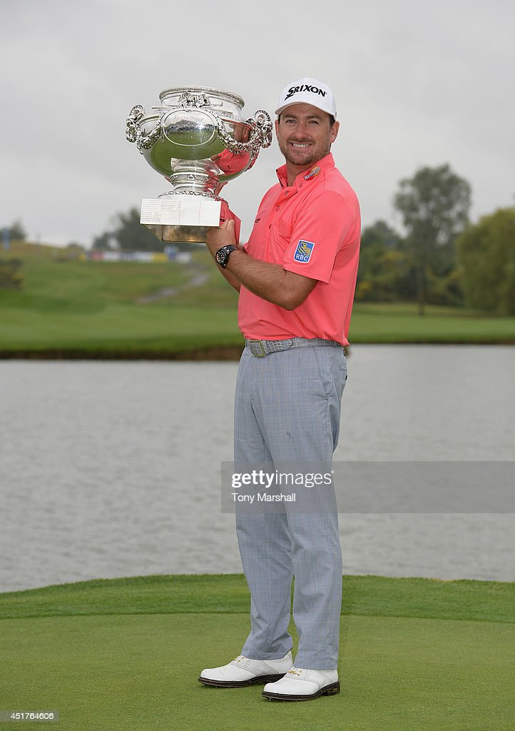 <a gi-track='captionPersonalityLinkClicked' href=/galleries/search?phrase=Graeme+McDowell+-+Golfer&family=editorial&specificpeople=196520 ng-click='$event.stopPropagation()'>Graeme McDowell</a> of Northern Ireland poses with the trophy after winning the Alstom Open de France - Day Four at Le Golf National on July 6, 2014 in Paris, France.