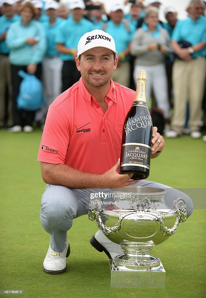 <a gi-track='captionPersonalityLinkClicked' href=/galleries/search?phrase=Graeme+McDowell&family=editorial&specificpeople=196520 ng-click='$event.stopPropagation()'>Graeme McDowell</a> of Northern Ireland poses with the trophy after winning the Alstom Open de France - Day Four at Le Golf National on July 6, 2014 in Paris, France.