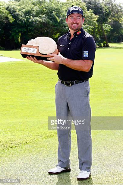 Graeme McDowell of Northern Ireland poses with the trophy after winning the three man playoff in the final round of the OHL Classic at the Mayakoba...