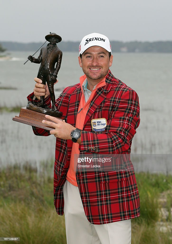 <a gi-track='captionPersonalityLinkClicked' href=/galleries/search?phrase=Graeme+McDowell+-+Golfer&family=editorial&specificpeople=196520 ng-click='$event.stopPropagation()'>Graeme McDowell</a> of Northern Ireland poses with the trophy after defeating Webb Simpson in a playoff during the final round of the RBC Heritage at Harbour Town Golf Links on April 21, 2013 in Hilton Head Island, South Carolina.