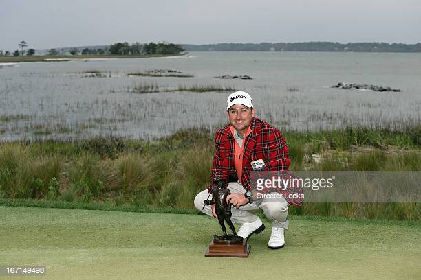 Graeme McDowell of Northern Ireland poses with the trophy after defeating Webb Simpson in a playoff during the final round of the RBC Heritage at...