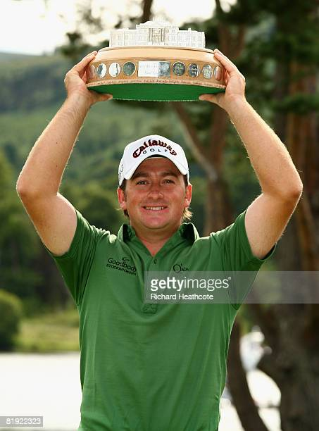 Graeme McDowell of Northern Ireland poses with the trophy following his victory at the end of the Final Round of The Barclays Scottish Open at Loch...