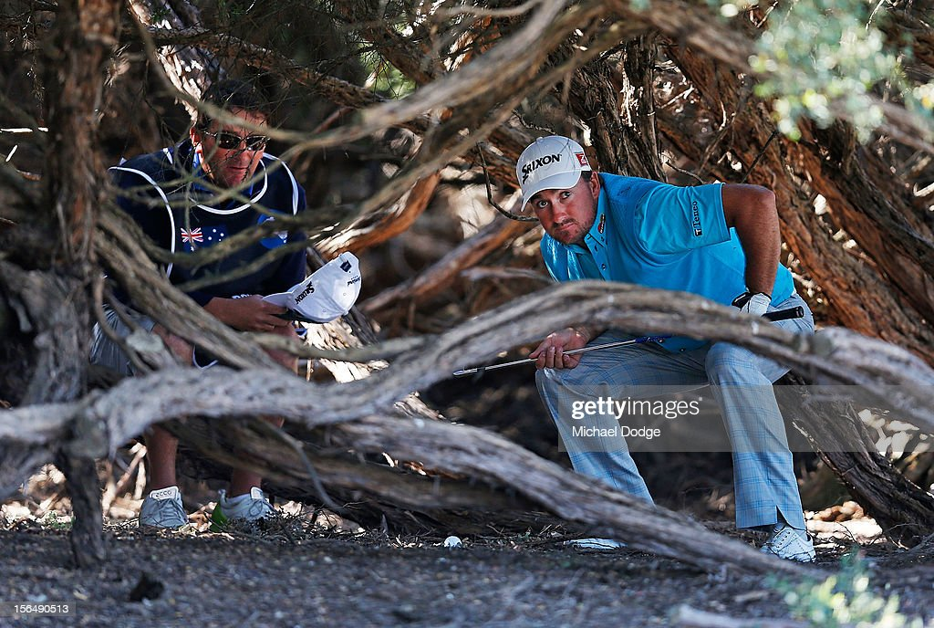<a gi-track='captionPersonalityLinkClicked' href=/galleries/search?phrase=Graeme+McDowell&family=editorial&specificpeople=196520 ng-click='$event.stopPropagation()'>Graeme McDowell</a> of Northern Ireland prepares to play a shot out from the trees on the 16th hole during day two of the Australia Masters at Kingston Heath Golf Club on November 16, 2012 in Melbourne, Australia.