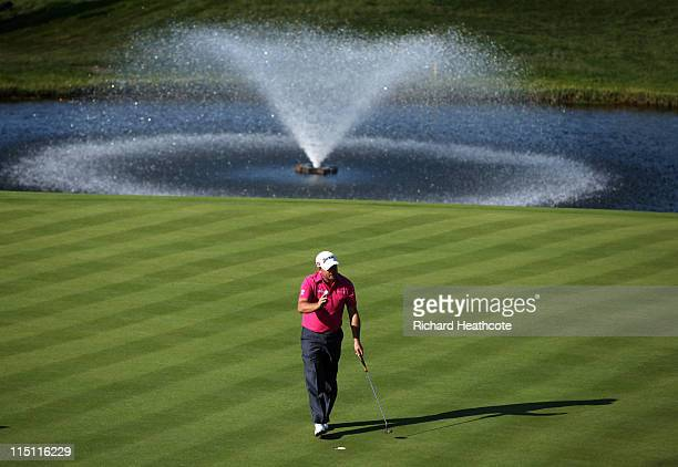 Graeme McDowell of Northern Ireland putts on the 18th green during the second round of the Saab Wales Open on the Twenty Ten course at The Celtic...