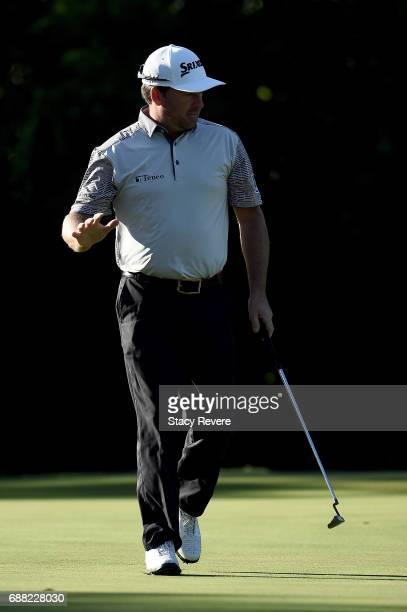 Graeme McDowell of Northern Ireland reacts after a birdie putt on the 11th green during Round One of the DEAN DELUCA Invitational at Colonial Country...