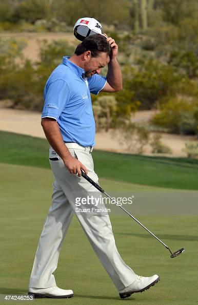 Graeme McDowell of Northern Ireland reacts his putt on the 16th hole during the quarterfinal round of the World Golf Championships Accenture Match...