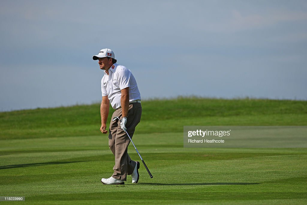 <a gi-track='captionPersonalityLinkClicked' href=/galleries/search?phrase=Graeme+McDowell&family=editorial&specificpeople=196520 ng-click='$event.stopPropagation()'>Graeme McDowell</a> of Northern Ireland reacts to his approach to the 18th green during the third round of the Saab Wales Open on the Twenty Ten course at The Celtic Manor Resort on June 4, 2011 in Newport, Wales.