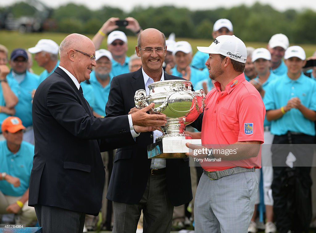 <a gi-track='captionPersonalityLinkClicked' href=/galleries/search?phrase=Graeme+McDowell&family=editorial&specificpeople=196520 ng-click='$event.stopPropagation()'>Graeme McDowell</a> of Northern Ireland receives the trophy after winning the Alstom Open de France - Day Four at Le Golf National on July 6, 2014 in Paris, France.