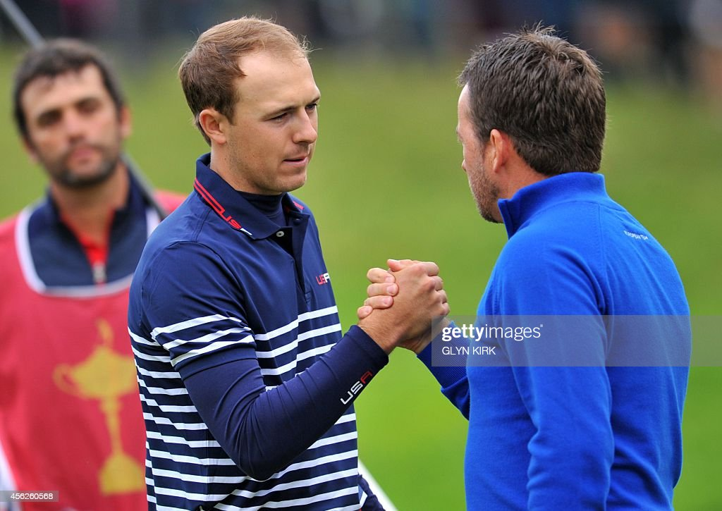 Graeme McDowell of Northern Ireland shakes hands with Jordan Spieth of Team US after McDowell won his singles match at Gleneagles in Scotland on...