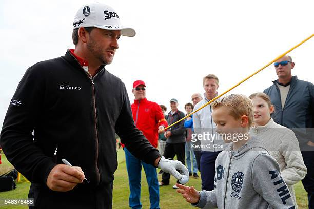 Graeme McDowell of Northern Ireland signs autographs during previews ahead of the 145th Open Championship at Royal Troon on July 12 2016 in Troon...