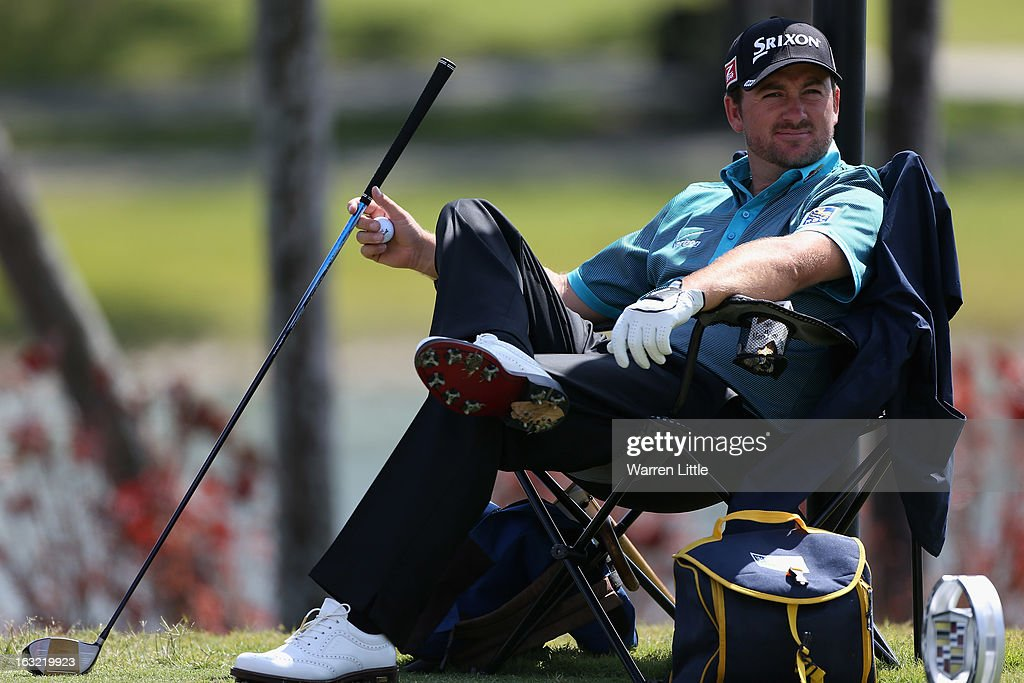 Graeme McDowell of Northern Ireland take break during a practice round ahead of the WGC - Cadillac Championship at the Doral Golf Resort & Spa on March 6, 2013 in Miami, Florida.