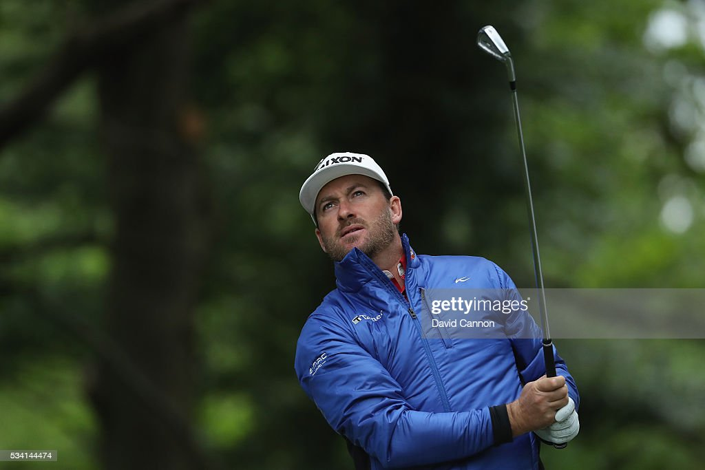 <a gi-track='captionPersonalityLinkClicked' href=/galleries/search?phrase=Graeme+McDowell&family=editorial&specificpeople=196520 ng-click='$event.stopPropagation()'>Graeme McDowell</a> of Northern Ireland tees off during the Pro-Am prior to the BMW PGA Championship at Wentworth on May 25, 2016 in Virginia Water, England.