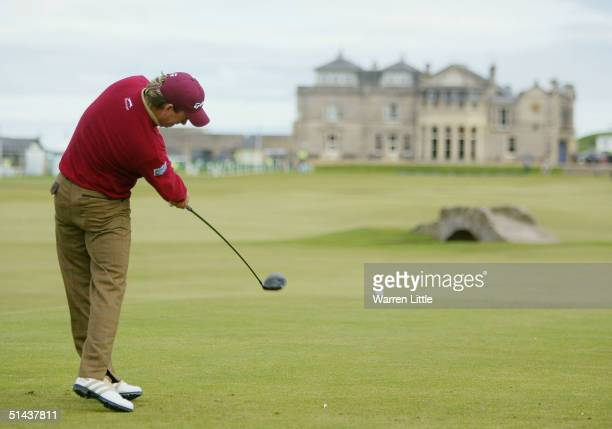 Graeme McDowell of Northern Ireland tees off on the 18th hole on his way to equaling the course record at St Andrews during the first round of the...
