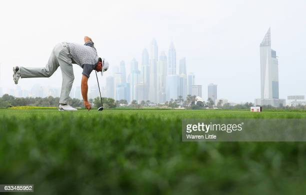 Graeme McDowell of Northern Ireland tees off on the 8th hole during the first round of the Omega Dubai Desert Classic at Emirates Golf Club on...