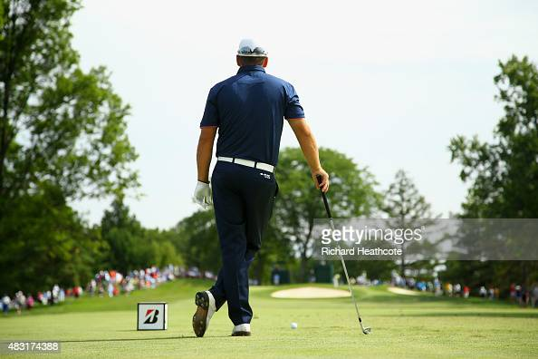 Graeme McDowell of Northern Ireland waits to hit off the 12th tee during the first round of the World Golf Championships Bridgestone Invitational at...
