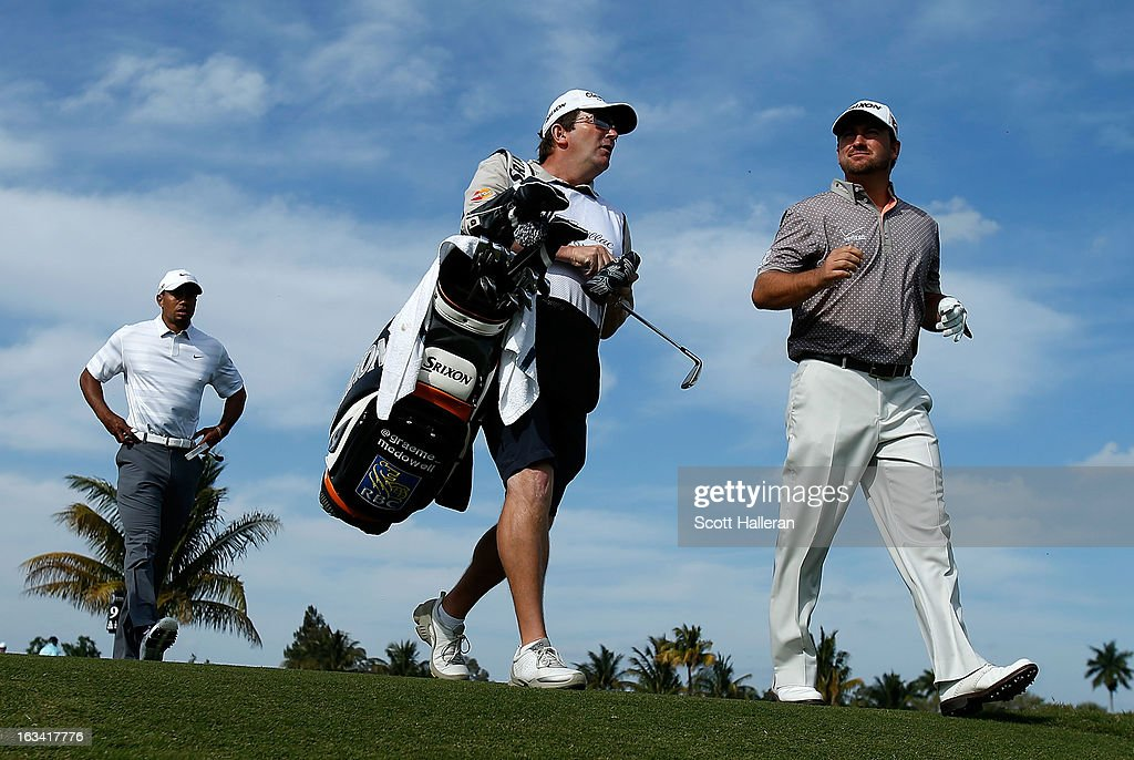 Graeme McDowell of Northern Ireland (R) walks alongside his caddie Ken Comboy and Tiger Woods on the ninth hole during the third round of the World Golf Championships-Cadillac Championship at the Trump Doral Golf Resort & Spa on March 9, 2013 in Doral, Florida.