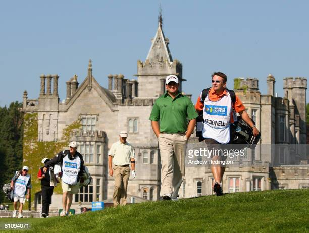 Graeme McDowell of Northern Ireland walks with his caddie Ken Comboy at the 16th hole during the first round of the Irish Open at the Adare Manor...