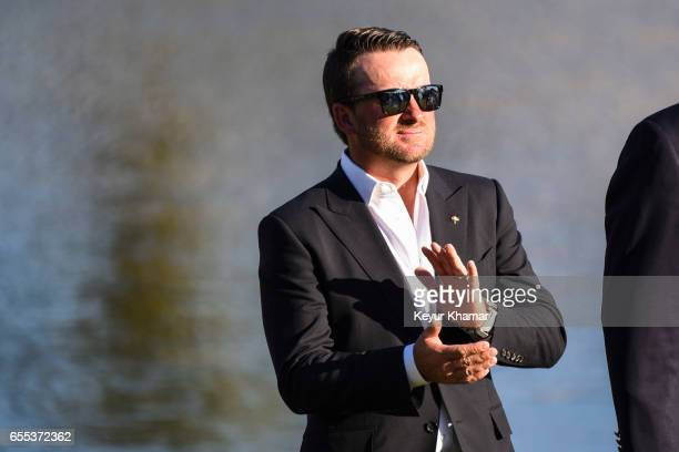 Graeme McDowell of Northern Ireland who served as the honorary cohost of the tournament applauds during the trophy ceremony following the final round...