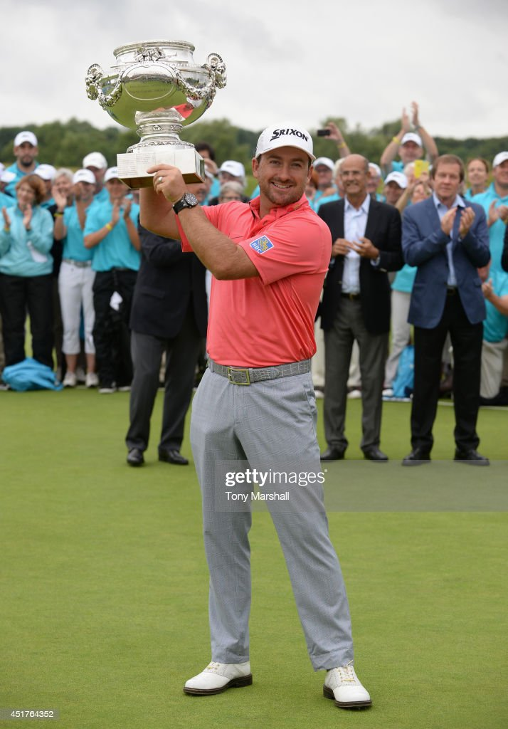 <a gi-track='captionPersonalityLinkClicked' href=/galleries/search?phrase=Graeme+McDowell+-+Golfer&family=editorial&specificpeople=196520 ng-click='$event.stopPropagation()'>Graeme McDowell</a> of Northern Ireland with the trophy after winning the Alstom Open de France - Day Four at Le Golf National on July 6, 2014 in Paris, France.