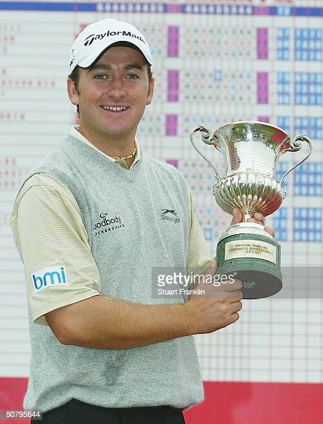 Graeme McDowell of Northern Ireland with the trophy for winning the rain delayed final round at The Telecom Italian Open at Castello di Tolcinasco...