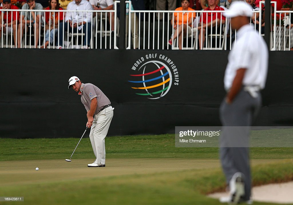 Graeme McDowell putts on the 18th hole during the third round of the WGC-Cadillac Championship at the Trump Doral Golf Resort & Spa in on March 9, 2013 in Doral, Florida.