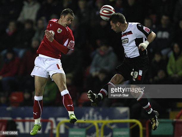 Graeme Murty of Charlton and Michael McIndoe of Bristol contest during the CocaCola Championship match between Bristol City and Charlton Athletic at...