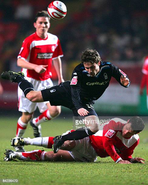 Graeme Murty of Charlton Athletic challenges Arron Davies of Nottingham Forest during the Coca Cola Championship match between Charlton Athletic and...