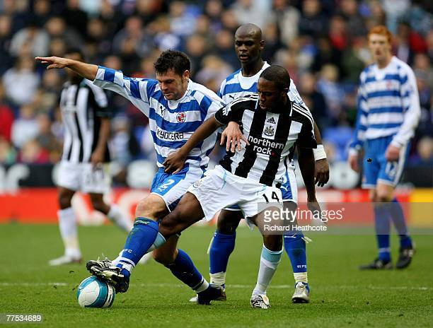 Graeme Murty of Reading battles with Charles N'Zogbia of Newcastle during the Barclays Premier League match between Reading and Newcastle United at...